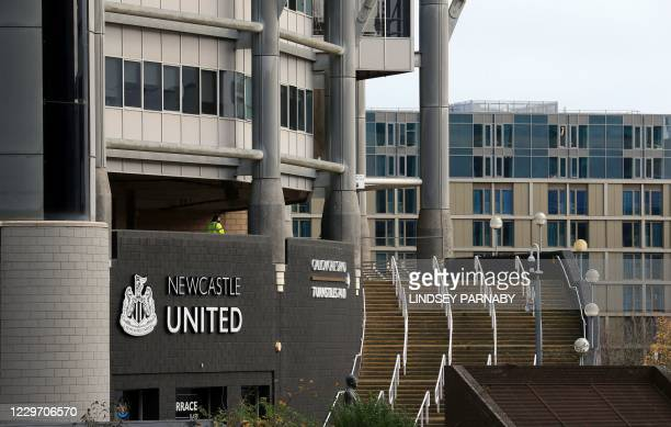 Lone security guard stands on duty outside the empty stadium ahead of the English Premier League football match between Newcastle United and Chelsea...
