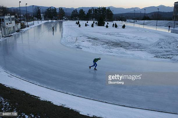 Lone skater John Matuszek from Toronto Ontario Canada takes a lap on the skating oval in Lake Placid New York Wednesday December 20 2006 The sound of...