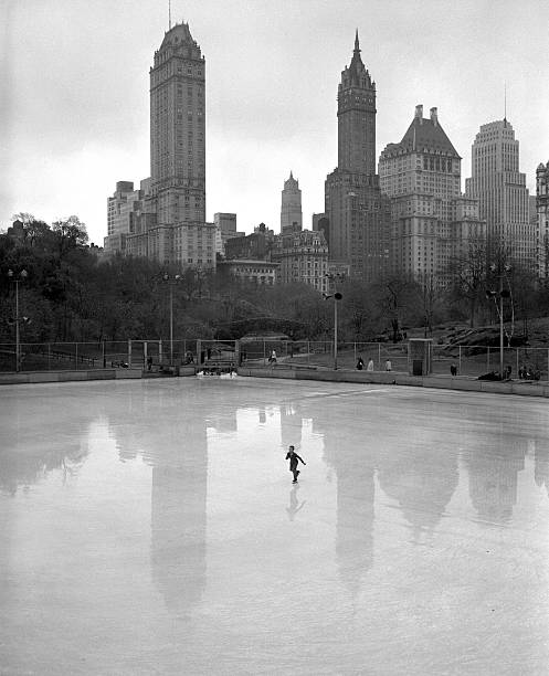 A lone skater on Wollman Memorial Rink with the reflection o