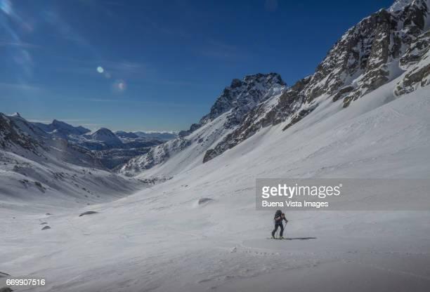 lone skier on a snowy slope - monte rosa foto e immagini stock