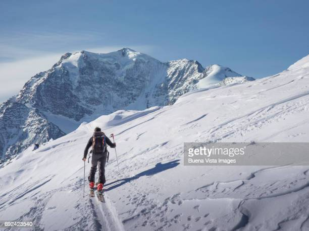 lone skier on a snowy slope. - winter sport stock pictures, royalty-free photos & images