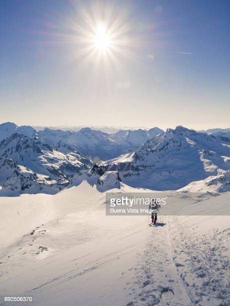 lone skier on a snowy slope