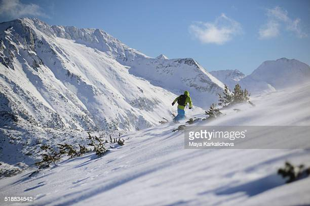 lone snowboarder in a windy scenery - bansko stock pictures, royalty-free photos & images
