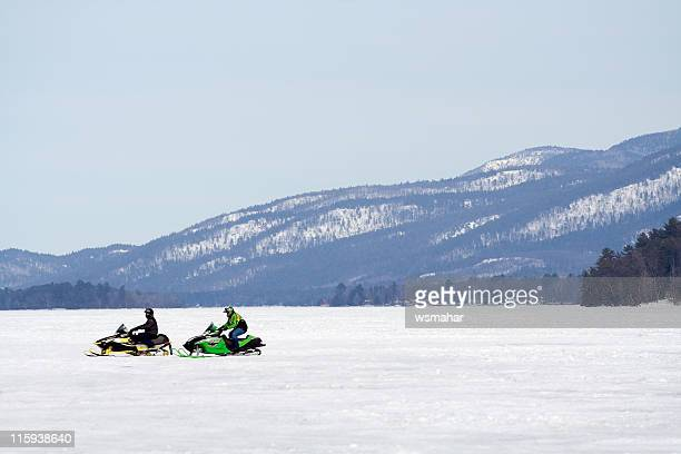 lone snowmobiles - lake george new york stock pictures, royalty-free photos & images