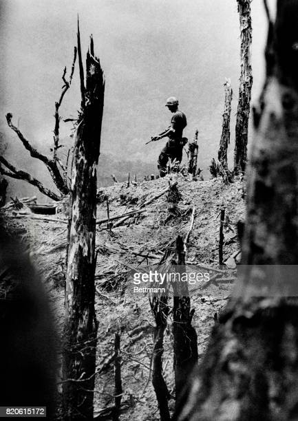 A lone soldier walks across a deserted hill in the A Shau Valley during the Vietnam War 1971 This is one of the photos that won David Hume Kennerly...