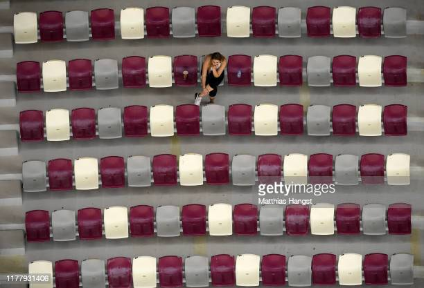 A lone spectators watches the action during day three of 17th IAAF World Athletics Championships Doha 2019 at Khalifa International Stadium on...