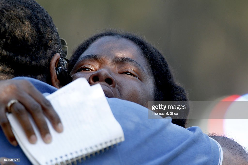 Lone Star College Freshman Sheketa Taylor hugs her father Judson Gimblin after they found each other on the Lone Star Campus on January 22, 2013 in The Woodlands, Texas. According to reports, three people were injured during a shooting on the courtyard between the Library and cafeteria.