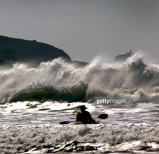 lone surf kayaker at whitesands bay, pembrokeshire - wales stock pictures, royalty-free photos & images
