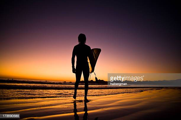 Lone surfer in the surf at sunset