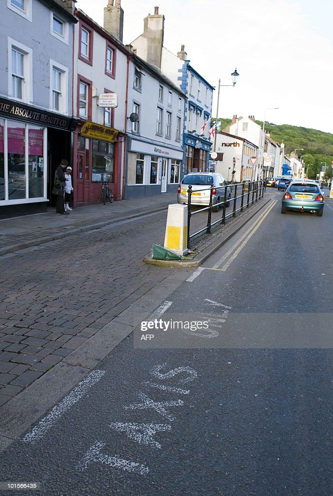 A lone taxi still sits in the taxi rank where Derrick Bird reportedly murdered someone on Duke St, Whitehaven, in Cumbria ,north west England on June 2, 2010. A gunman killed at least 12 people after going on a rampage in a popular tourist area in northwest England on Wednesday, before apparently turning the gun on himself. During the killing spree, police warned frightened local residents and tourists to stay indoors for their own protection. Bird's body was eventually found in woods, along with a gun, near the village of Boot.