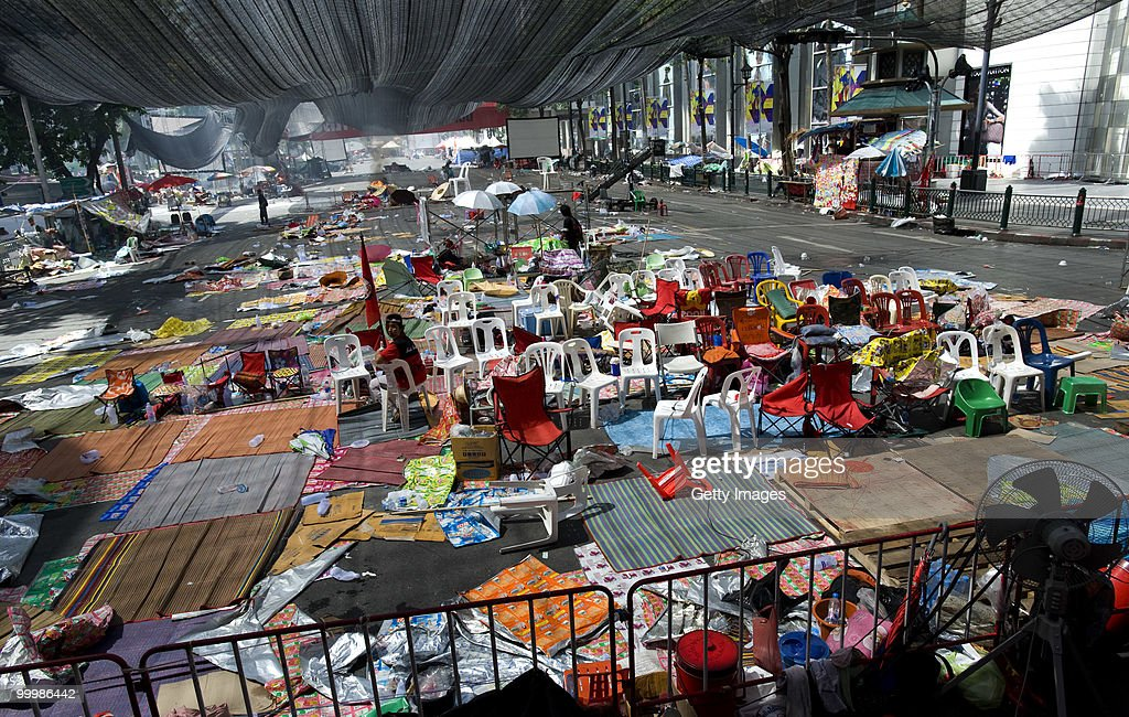 A lone Thai anti-government red shirt protester sits in the abandoned main rally site after Thai military forces moved in and protest leaders ended the rally after more than two months on May 19, 2010 in Bangkok, Thailand. At least 5 people are reported to have died as government forces sought to overrun barricades raised in and around the city centre by anti-government protestors. Red-shirt leaders have now surrendered, ending their blockade in the aftermath of a sixth day of violence, leaving the army in control and a night time curfew to be imposed.