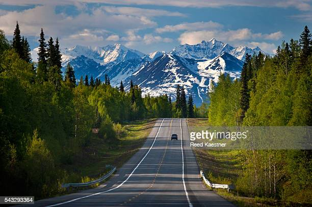 A lone traveler on a remote road in Alaska