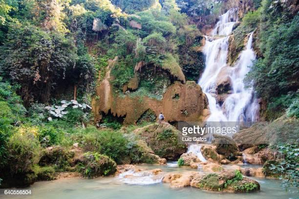 Lone traveller looking at Kuang Si falls