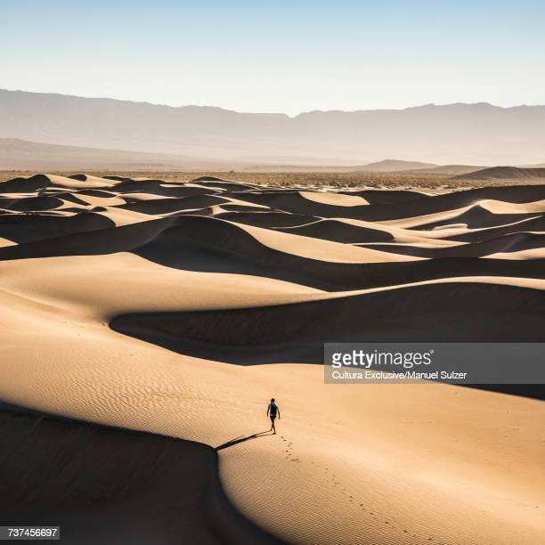 Lone trekker on Mesquite Flat Sand Dunes, Death Valley National Park, Furnace Creek, California, USA