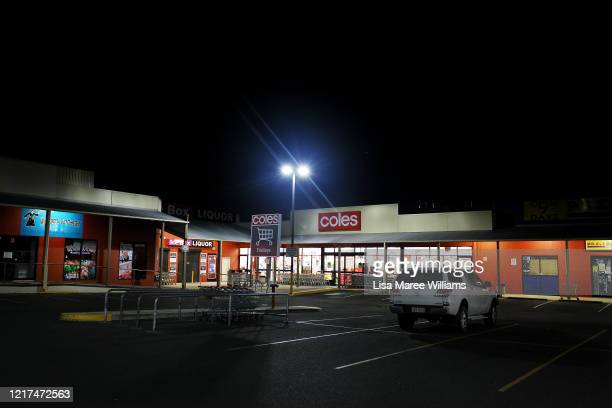 Lone vehicle sits in a Coles Supermarket carpark during night trade on April 02, 2020 in Tenterfield, Australia. The Australian government has...