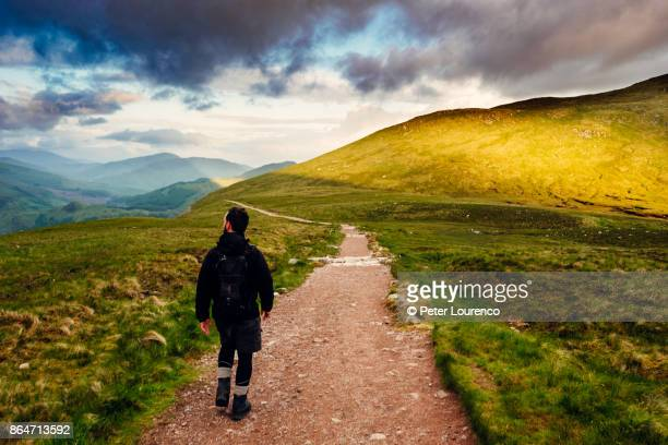lone walker - peter lourenco stock pictures, royalty-free photos & images