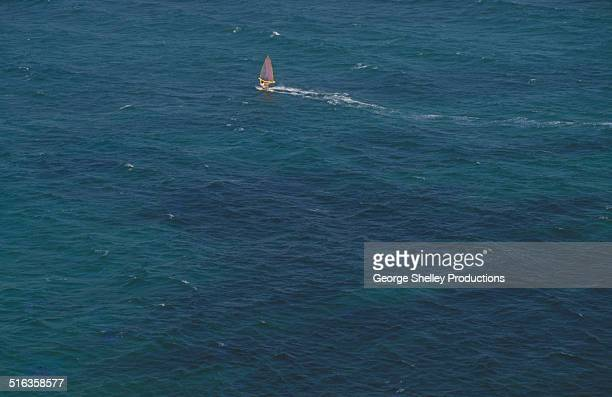 A lone windsurfer sails off Ftelia beach