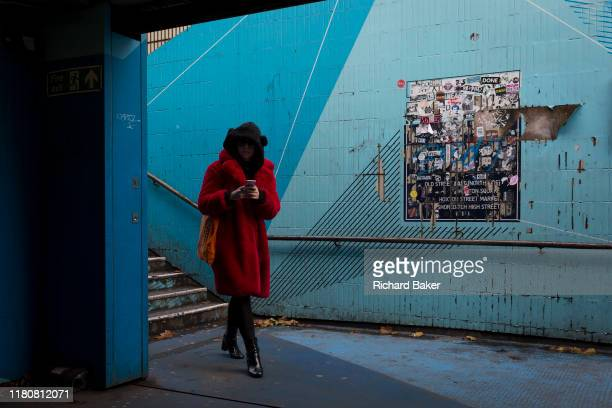 Lone woman enters the underpass leading into the Old Street station in Shoreditch, on 4th November 2019, in London, England.