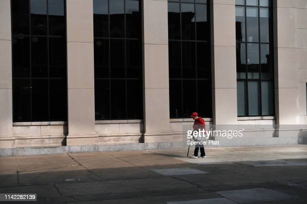 Lone woman walks through the city on April 11, 2019 in Binghamton, New York. Due to an aging population, falling birthrates and slowing immigration,...