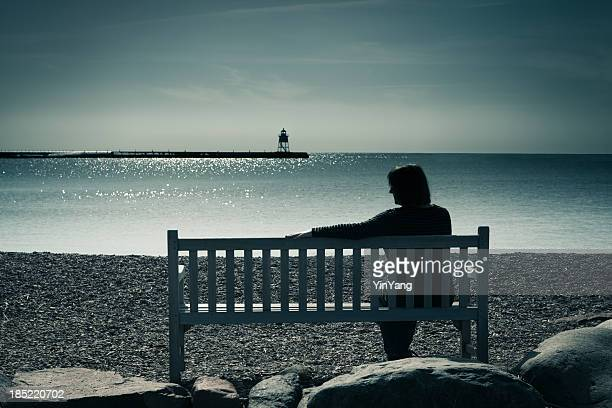 lone woman, widowed, divorced, or lonely, contemplating grief, sadness, depression - mourning stock pictures, royalty-free photos & images