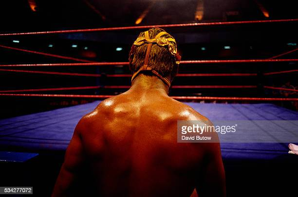A lone wrestler faces the ring during the 1998 television special The Secrets of Professional Wrestling