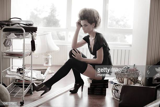 loneliness - women in stockings and high heels stock photos and pictures