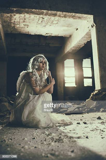 Lonely angel in a ruin.