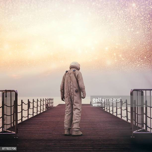 Lonely astronaut on the beach