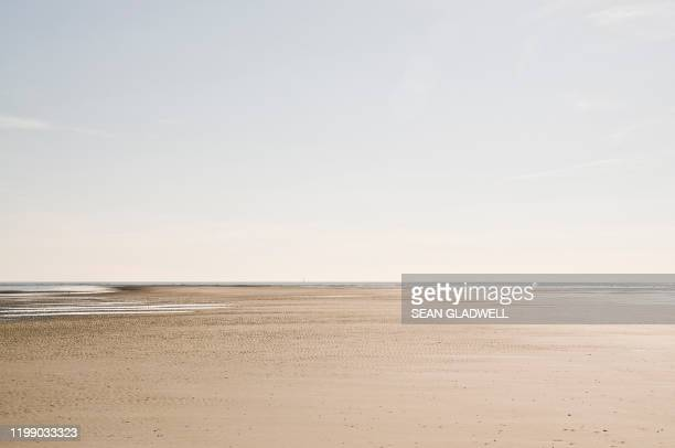 lonely beach soft colors - panoramic stock pictures, royalty-free photos & images