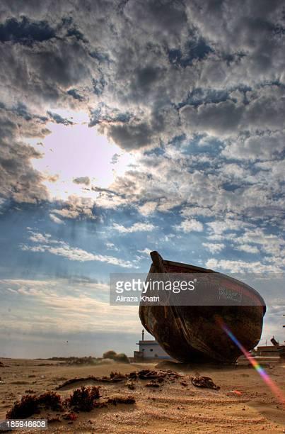 CONTENT] Lonely boat at sea shore Hawksbay beach Karachi Pakistan