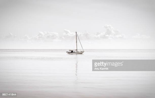 lonely boat near dry tortugas - dry tortugas stock pictures, royalty-free photos & images