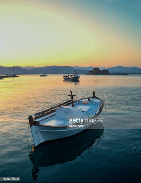 lonely boat - peloponnese stock photos and pictures