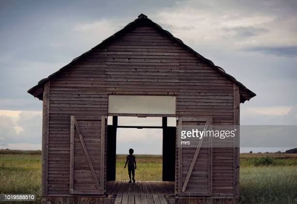lonely boy - farmhouse stock pictures, royalty-free photos & images