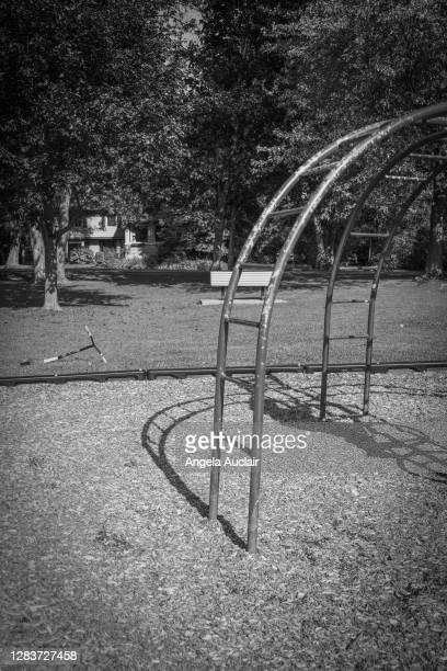 lonely boy plays in park during pandemic - angela auclair stock pictures, royalty-free photos & images