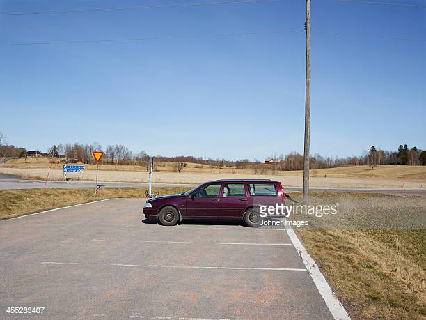 lonely car on parking - dalsland stock photos and pictures