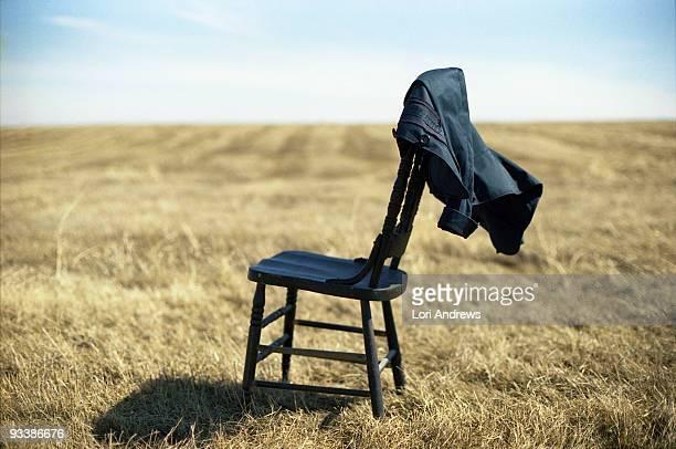Lonely chair in an open field
