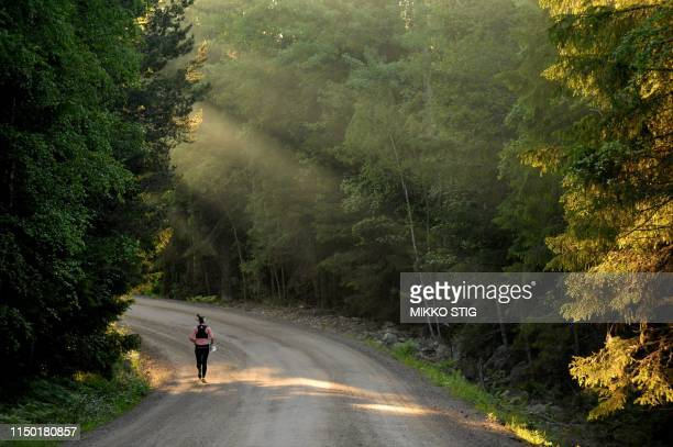 A lonely competitor competes during men's Jukola Relay of the international orienteering relay competition KangasalaJukola in Kangasala Finland on...