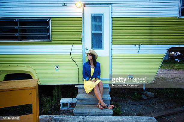 Lonely cowgirl waiting at her trailer