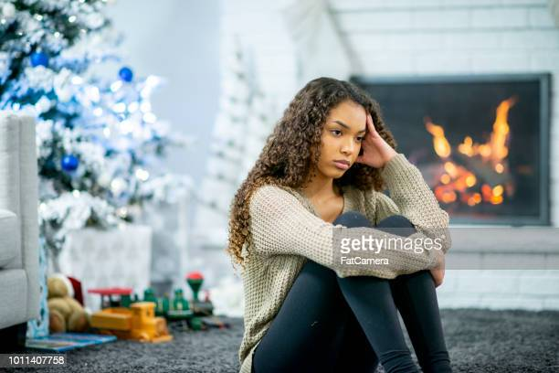 lonely during the holidays - holiday stress stock pictures, royalty-free photos & images