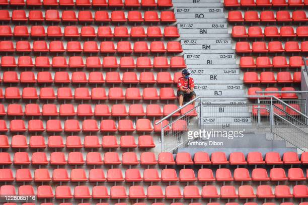 Lonely fan in the stands during the friendly match between Valenciennes and Union Saint Gilloise on August 15, 2020 in Valenciennes, France.