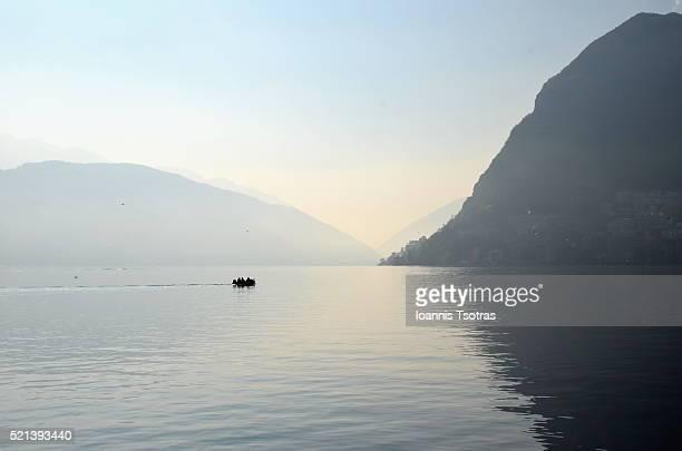 lonely fishermen - スイス ルガーノ ストックフォトと画像