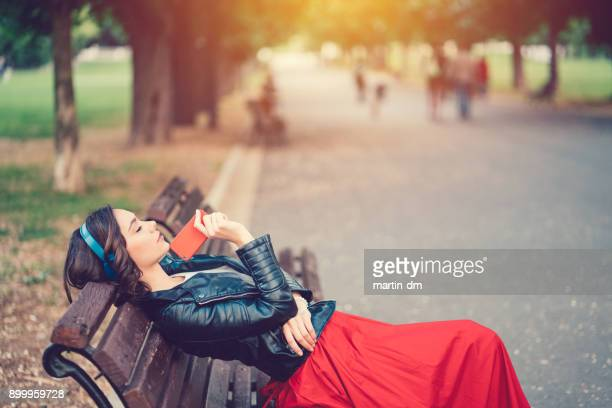 lonely girl in the park - bench stock pictures, royalty-free photos & images