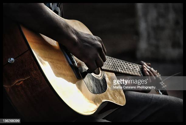 lonely guitar play - classical guitar stock photos and pictures