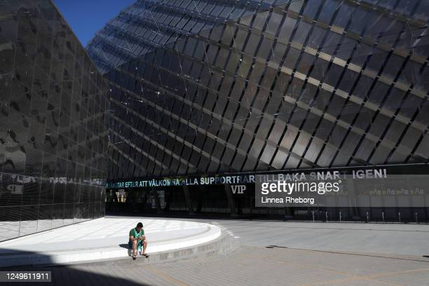 Lonely Hammarby fan is sat outside the stadium prior to the Allsvenskan match between Hammarby IF and Ostersunds FK at Tele2 Arena on June 14, 2020...
