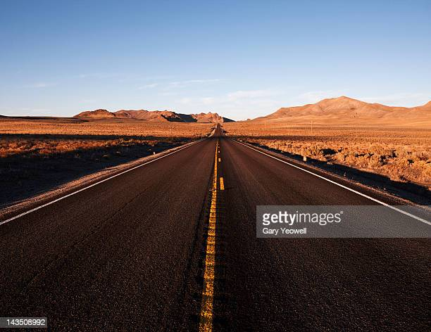 lonely highway leading into the distance - yeowell stock pictures, royalty-free photos & images