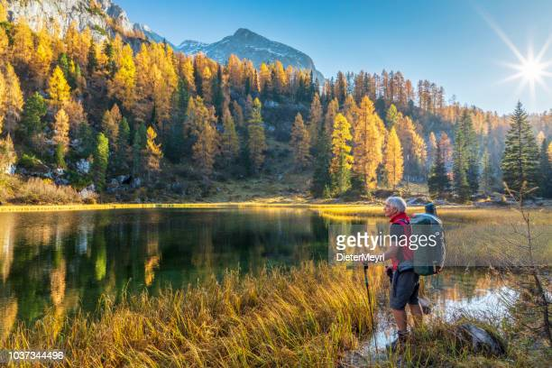 Lonely Hiker at Alpin Lake Schwarzensee in fall, Nationalpark Berchtesgaden - Alps