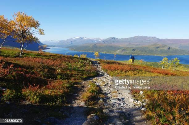 a lonely hiker on kungsleden trail at saltoluokta - swedish lapland stock photos and pictures
