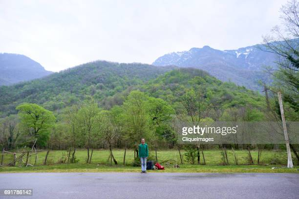 lonely hitchhiker on road - cliqueimages stock pictures, royalty-free photos & images