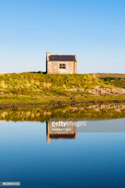 Lonely house and lake in Connemara, County Galway, Republic of Ireland
