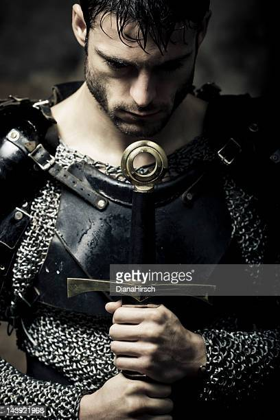 lonely knight in the darkness - warrior person stock photos and pictures